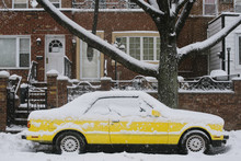 Yellow Car During Blizzard