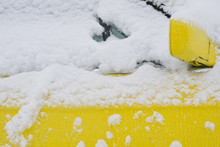 Yellow Car Under Snow