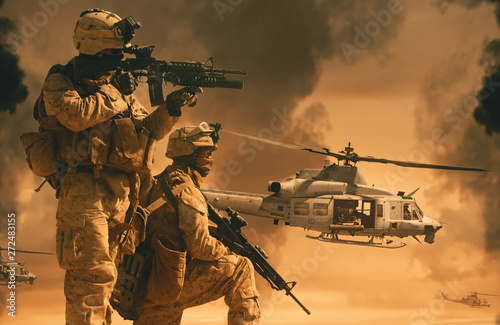 Military helicopter and forces in the battlefield at sunset