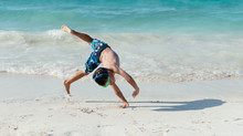 Little Boy Doing A Cartwheel O...