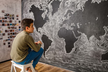 Boy Drawing World's Map In The...