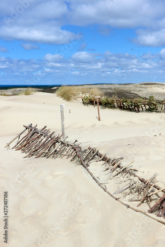 Old broken wooden dune fence, Curonian spit, Lithuania, Baltic sea coast #272487186