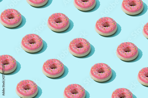 Trendy sunlight Summer pattern made with pink doughnut on bright light blue background Canvas Print