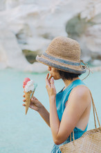Woman With Ice Cream At Pond