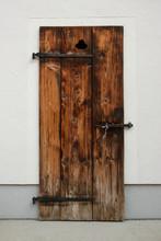 Old Rustic Wooden Door With Iron Hinges