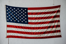 American Flag On A White Wall