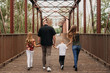 Family Walking Together on Bridge