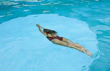 Woman Swimming Underwater In P...