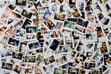 Many Polaroid Pics Scattered O...