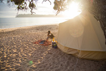 Woman Camping With Tent On Bea...