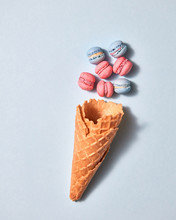 Multicolored Homemade Macaroons With Waffle Cone On A Light Gray Background, Place Under Text.
