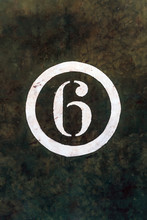 Number 6 Printed On White Over Grunge Wall
