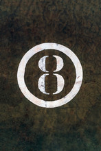Number 8 Printed On White Over Grunge Wall