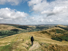Young Male Walking With His Dog From Mam Tor To Hollins Cross. Derbyshire, UK.
