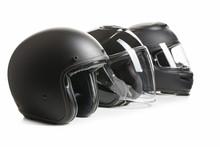 Three Black Motorcyle Helmets.