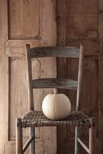 White Pumpkin On Old Wooden Chair