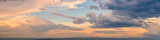Fototapeta Na sufit - Dramatic light through the clouds against the backdrop of an exciting, bright stormy sky at sunset. panorama, natural composition
