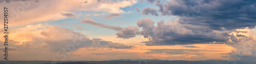 Dramatic light through the clouds against the backdrop of an exciting, bright stormy sky at sunset. panorama, natural composition