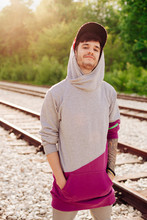 Young Urban Man On The Railroad