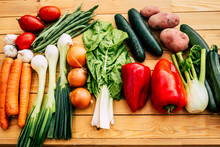 Healthy Lifestyle Eating All Kind Of Vegetables And Not Put On Weight . Wooden Table With Assortment Of Raw Vegetables Freshly Picked From The Garden. Full Of Colors