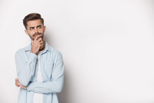 Pensive Guy Feeling Doubtful Pose Isolated On White Studio Background