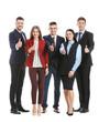 Leinwandbild Motiv Team of business people showing thumb-up gesture on white background