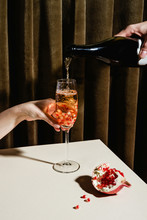 Man's Hand Pouring Champagne Into Glass