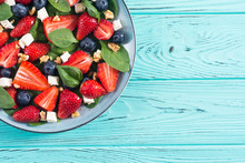 Summer Strawberry Salad With Spinach , Cheese , Nuts And Blueberry