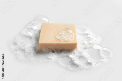 Fotografia, Obraz  Soap bar and foam on white background