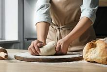 Female Baker Preparing Bread Dough At Table, Closeup
