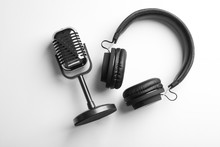 Retro Microphone And Headphones On White Background, Top View