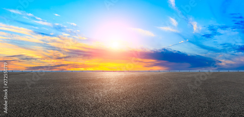 Asphalt road and sunset sky,panoramic view