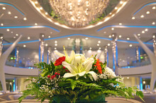 Festive Floral Flower Bouquet Decoration On Captain´s Table In Dining Room Restaurant Aboard Luxury Cruise Ship Ocean Liner During Christmas X-Mas XMas Holiday Season
