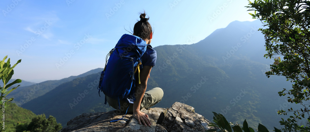 Fototapety, obrazy: Successful woman backpacker sit on cliff's edge at mountain top