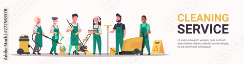 Obraz janitors team cleaning service concept male female mix race cleaners in uniform working together with professional equipment flat full length horizontal banner copy space - fototapety do salonu