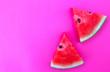 Leinwanddruck Bild - Watermelon on the pink backdrop in the studio.