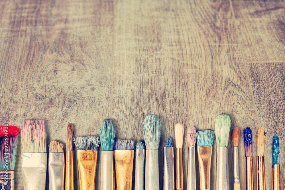 Fototapety, obrazy: Row of artist paint brushes  on background
