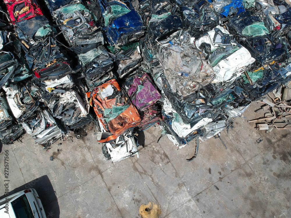 Fototapety, obrazy: Cars in junkyard, pressed and packed for recycling.