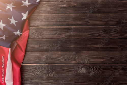 Canvas Prints Countryside USA flag sideways on an empty wooden background