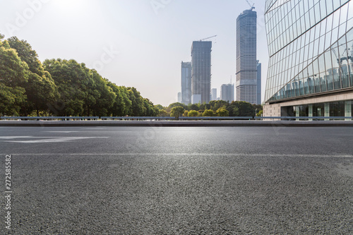 Foto auf Leinwand Shanghai Panoramic skyline and modern business office buildings with empty road,empty concrete square floor