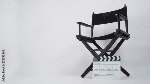Clapper board or movie slate with director chair use in video production or m...