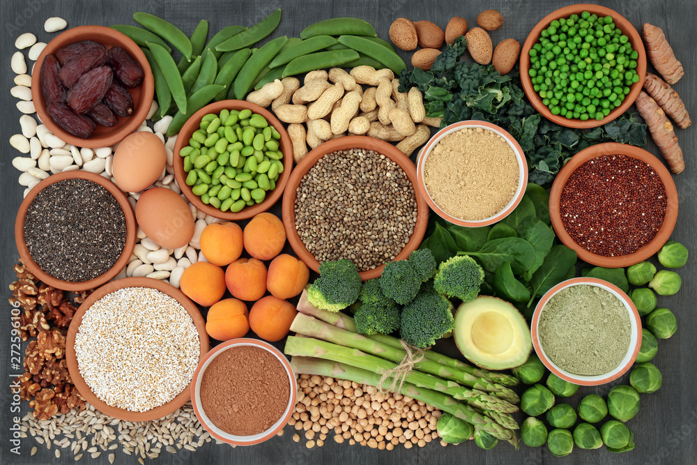 Fototapety, obrazy: Vegan health food high in protein with legumes, fresh vegetables, dried fruit, grains, dairy, supplement powders, seeds and nuts. Super foods high in dietary fibre, vitamins & antioxidants. Flat lay.
