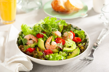 Fresh summer salad with shrimp, avocado and tomato