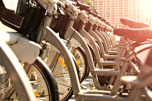 Bicycles that abreast waiting for people to travel around the city Wallpaper Mural