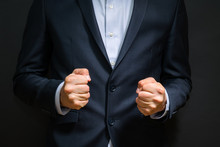 Business Man Fists Clenched In...