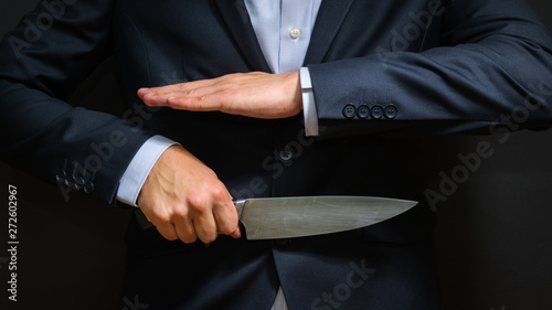 Fototapety, obrazy: Criminal with big knife hidden. Cold weapon, burglary, homicide,