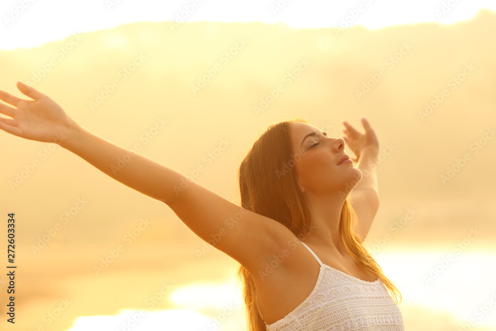 Fototapety, obrazy: Relaxed woman stretching arms breathing fresh air at sunset