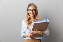 Pretty Blonde Business Woman Posing Isolated Grey Wall Background Holding Folder.