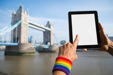 Hand Wearing Rainbow Color Gay...