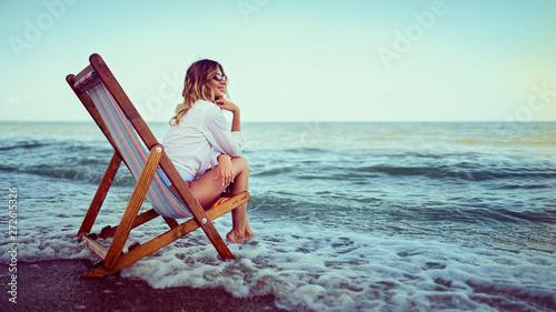 Fotografia, Obraz Pretty woman relaxing on a lounger beach